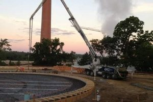 Concrete being properly placed by a concrete pump truck and boom provided by L&N Concrete Pumping